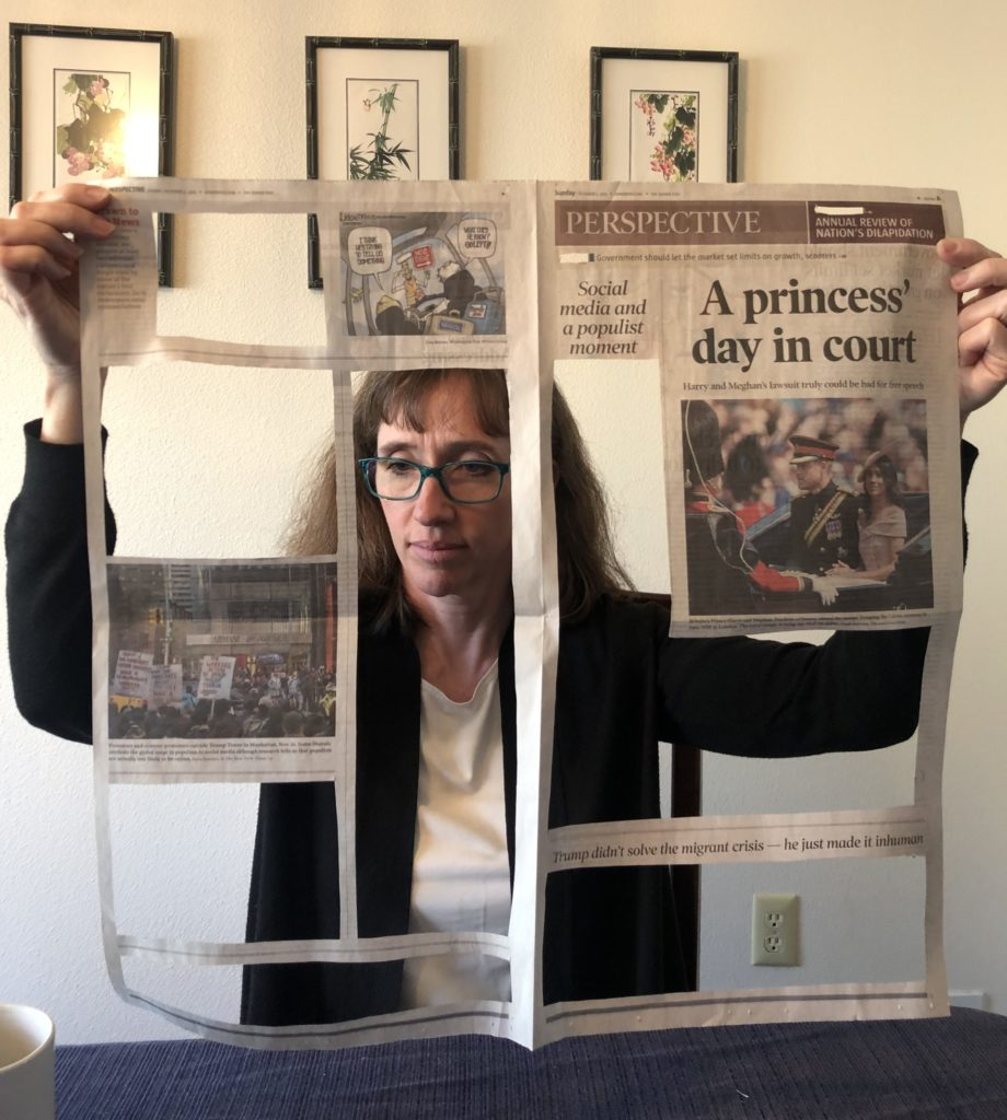 Woman reading a Denver Post opinion page, out of which the text of male writers has been cut, leaving many empty spaces.